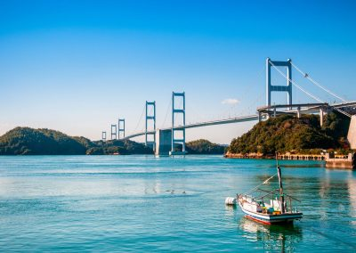 A boat in front of the Shimanami Kaido