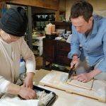 A guest makes soba noodles with a local